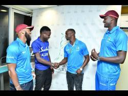 West Indies Test players John Campbell (left), Kemar Roach and Jason Holder (right) greet Jamaica Under-19 cricket captain Kirk McKenzie at Sabina Park on Wednesday.
