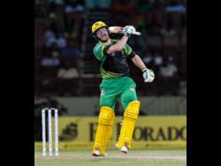 Glenn Phillips of Jamaica Tallawahs celebrates his century during the Hero Caribbean Premier League Play-Off match 32 between St Kitts & Nevis Patriots and Jamaica Tallawahs at the Guyana National Stadium, on September 12, 2018.