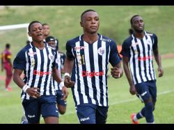 Jamaica College's Gorrington Baker (centre) celebrates with his teammates after scoring against Wolmer's Boys in the ISSA/Digicel Manning Cup at the Stadium East field on Monday, September 16, 2019.