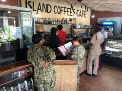 Customers wait to be served in Island Coffee Cafe.