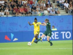 Jody Brown (left) moves away from Australia's Karly Roetbakken in Jamaica's first-round clash against the Aussies in the FIFA Women's World Cup in Grenoble, France, on Tuesday June 18, 2019.
