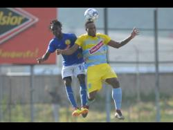 Waterhouse FC's Shawn Lawes (right) wins an aerial battle with Vere United Devroy Grey during a Red Stripe Premier League encounter earlier this season.