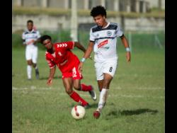 File UWI's Patrick Brown looking on while Cavalier player Leonard Rankine (right) dribbles away in their Red Stripe Premier League encounter at the UWI, Mona Bowl,on Sunday December 2,2018.