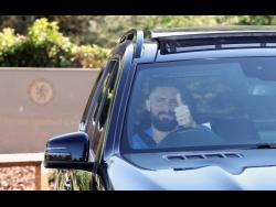 Chelsea's French player Olivier Giroud leaves the club's Cobham training ground after the English Premier League announced players can return to training in small groups from May 19, 2020.