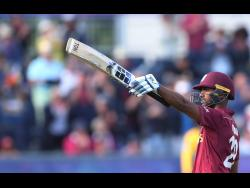File West Indies' batsman Nicholas Pooran raises his bat to celebrate scoring a century during the Cricket World Cup match between Sri Lanka and the West Indies at the Riverside Ground in Chester-le-Street, England, July 1, 2019.