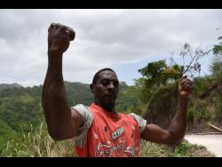 Calvin 'Cow' Scott shows off his muscles.