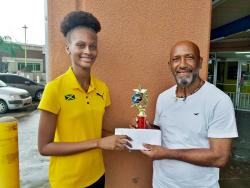 Clarendon businessman Andrew 'Nazi' Mattrasingh presents a scholarship package to Ruddayne Peters.