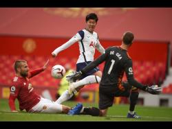 Tottenham's Son Heung-min (centre) scores his side's second goal during the English Premier League match against Manchester United at Old Trafford in Manchester, England, on Sunday, October 4.
