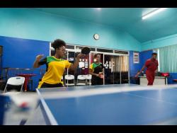 File Sisters Gianna Lewis (left) and Tsenaye Lewis of the Jamaica National Table Tennis team take part in a training session on Thursday, July 11, 2019 at the Gleaner Company (Media) Limited sports club.