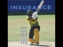 Jamaica Scorpions' Brandon King accumulates runs on the offside during his innings of 97 against the T&T Red Force in a Regional Super 50 match yesterday.