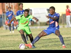 File Mount Pleasant's Kevaughn Isaacs (right) gets a toe to the ball ahead of Molynes United's Tyrique Wilson during a Red Stripe Premier League match at the Constant Spring Sports Complex on December 15, 2019.