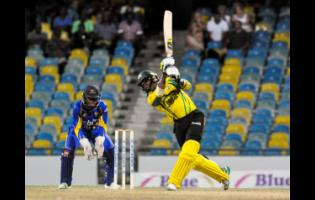 Andre McCarthy hits a four during a Windies Super50 Cup match between Jamaica Scorpions and Barbados Pride on October 20, 2018.