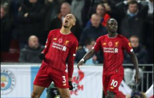 Liverpool's Fabinho celebrates after scoring his side's opening goal during their English Premier League match against Manchester City at Anfield Stadium in Liverpool yesterday.