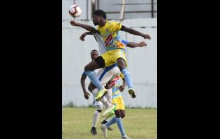 Colorado Murray (right) from Waterhouse FC jump high to head during their Red Stripe Premier League football match at the Spanish Town Prison Oval on November 10, 2019.