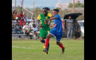 Vere United's Devroy Grey challenges Portmore United's Lamar Walker for the ball during their RSPL match on September 8, 2019.