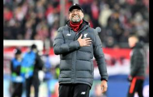 Liverpool's manager Jurgen Klopp celebrates at the end of the Group E Champions League match between Salzburg and Liverpool, in Salzburg, Austria, last Tuesday.