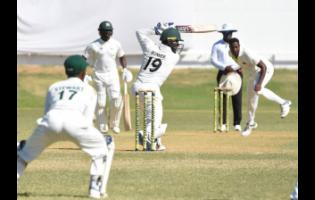 Jamaica Scorpions batsman Nkrumah Bonner (19) plays a shot through the offside during the final day of play against the Windward Islands Volcanoes in the Cricket West Indies Professional Cricket League Regional 4-Day Championship at Sabina Park, Kingston, yesterday.