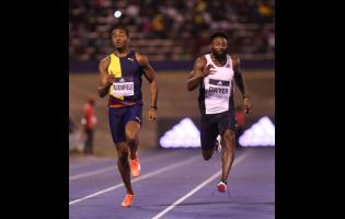 Akeem Bloomfield (left) moves away from Rasheed Dwyer to win the men's 200m sprint in 20.34 seconds at the Racers Grand Prix at the National Stadium on Saturday, June 8, 2019.