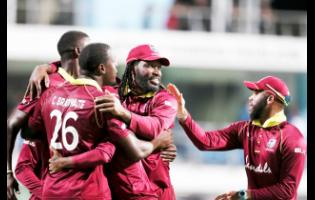 West Indies players celebrate beating England by 26 runs in a One-Day International match at Kensington Oval in Barbados last year.