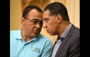 Health and Wellness Minister Dr Christopher Tufton (left)  and  Prime Minister Andrew Holness.
