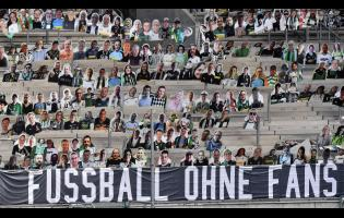 Thousands of cardboards with photos of Borussia Monchengladbach soccer fans are displayed on the stands at the stadium in Monchengladbach, Germany, ob Tuesday, August 4.