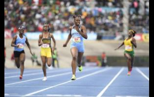 FILE Kevona Davis of Edwin Allen wins the Class Two girls 200m finals with a record time of 22.72 on March 24, 2018.  ISSA/Grace Kennedy Boys and Girls Champs 2018 held at The National Stadium in Kingston on Saturday March 24, 2018   *** Local Caption *** Gladstone Taylor / Photographer  Kevona Davis of Edwin Allen (second right) wins the Class 2 girls' 200m finals in a record time of 22.72 at the SSA/GraceKennedy Boys and Girls' Athletics Championships at the National Stadium  on Saturday March 24, 2018.