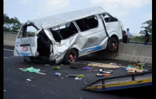 Five people are confirmed dead after this minibus crashed into a small truck on Highway 2000 yesterday.