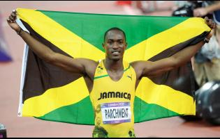 Hansle Parchment celebrating his bronze medal in the men's 110 metres hurdles at the 2012 London Olympic Games in England.