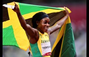 Jamaica's Elaine Thompson-Herah celebrates winning the Tokyo 2020 Olympics women's 200 metres final.