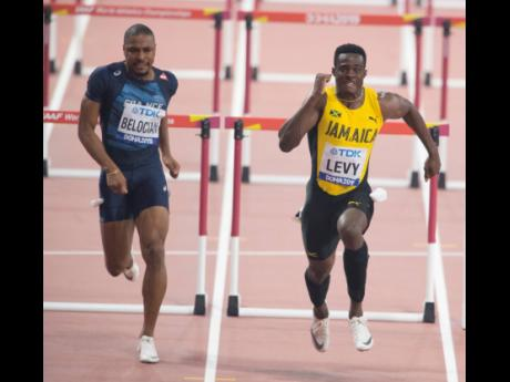 Ronald Levy wins his heat ahead of Wilhem Belocian of France in the preliminary round of the men's 110m hurdles at the 2019 IAAF World Championships in Doha, Qatar, on September 30.