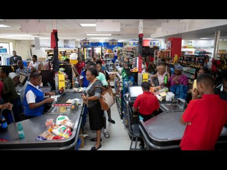 Members of the public shopping for supplies at the Hi-Lo Supermarket located on Old Hope Road in St Andrew last Friday.
