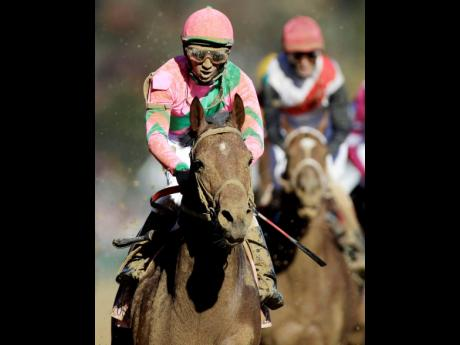 Jamaican jockey Rajiv Maragh reacts after riding Caleb's Posse to victory in the Dirt Mile race at the Breeders' Cup horse races at Churchill Downs in Louisville, Kentucky in 2011.