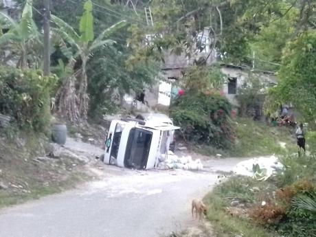 The overturned truck in which Nathan and others were travelling.