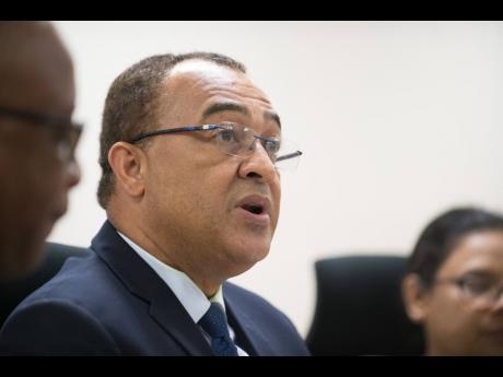 Health Minister Dr Christopher Tufton