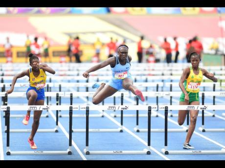 Action from the Class Four Girls 70m hurdles final at the ISSA/GraceKennedy Boys and Girls' Athletics Championships at the National Stadium in Kingston on Saturday, March 30, 2019.