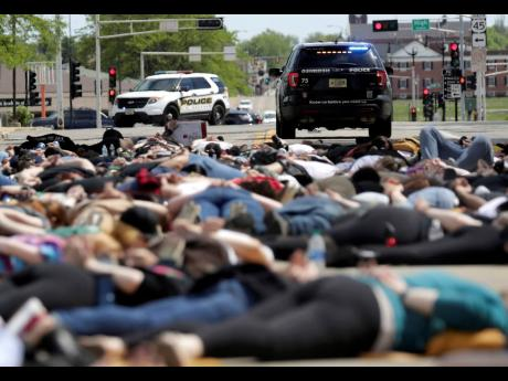 Protesters lie on the ground during a Black Lives Matter rally in Oshkosh, Wisconsin, yesterday.