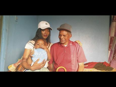 Martin spends time with great-granddaughter Akeba Martin (left) and great-great-grandson Ayden Brown.