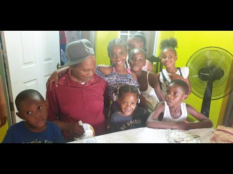Martin enjoys his birthday with some of his great-grandchildren.
