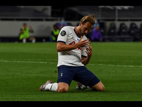 Tottenham's Harry Kane reacts after missing a shot during the English Premier League match.