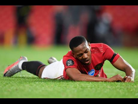 Manchester United's Anthony Martial spreads himself on the turf during the English Premier League match against Southampton at Old Trafford in Manchester, England, yesterday.