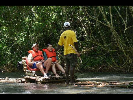 Rafting on the Martha Brae River.  Raft captains are among the category of workers who will benefit from the tourism pension scheme.