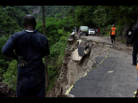 The Gordon Town main road, in the vicinity of Stand Up Hill, has been closed to all forms a traffic after a huge section of the roadway collapsed during heavy rains recently.
