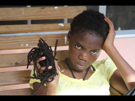 Princess Nzinga King shows some of her dreadlocks.