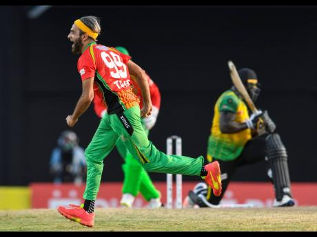 Photo by Randy Brooks - CPL T20/Getty Images  Imran Tahir (left) of Guyana Amazon Warriors celebrates the dismissal of Kennar Lewis (right) of Jamaica Tallawahs during the 2021 Hero Caribbean Premier League match 29 between Guyana Amazon Warriors and Jamaica Tallawahs at Warner Park Sporting Complex on Sunday in Basseterre, St Kitts, Saint Kitts and Nevis.