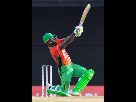 Photo by Randy Brooks - CPL T20/Getty Images  Romario Shepherd of Guyana Amazon Warriors hits a six during the 2021 Hero Caribbean Premier League match 29 between Guyana Amazon Warriors and Jamaica Tallawahs at Warner Park Sporting Complex on Sunday in Basseterre, St Kitts, Saint Kitts and Nevis.